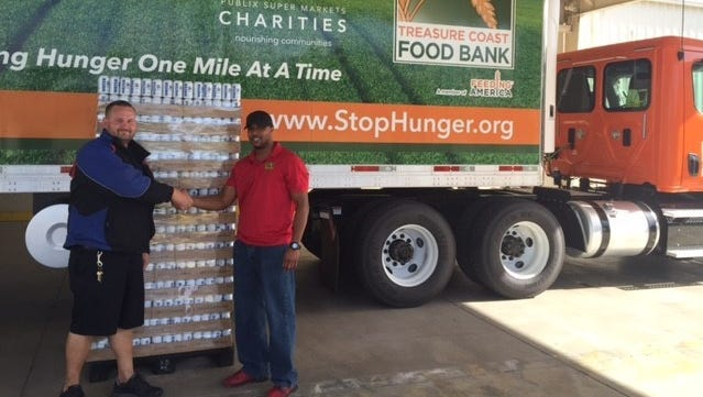 Water being donated by Southern Eagle Distributing is ready to load on a Treasure Coast Food Bank truck.