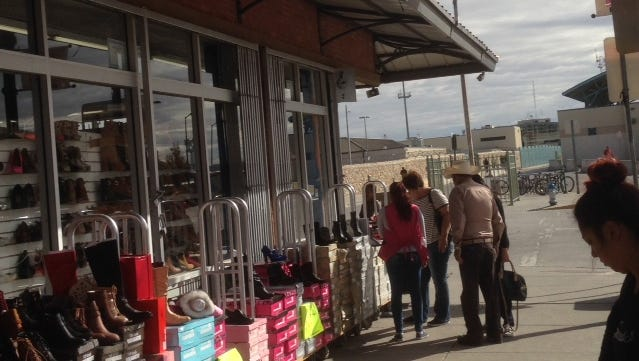 Shoppers look at shoes outside a Downtown El Paso store last week. El Paso's state sales tax rebates increased 2.7 percent for September sales, a new report shows.