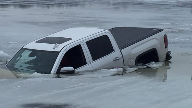 A GMC pickup went through the ice on Jan. 22, 2017 on Horseshoe Lake. Two occupants of the vehicle were able to get out before it sank into the water.