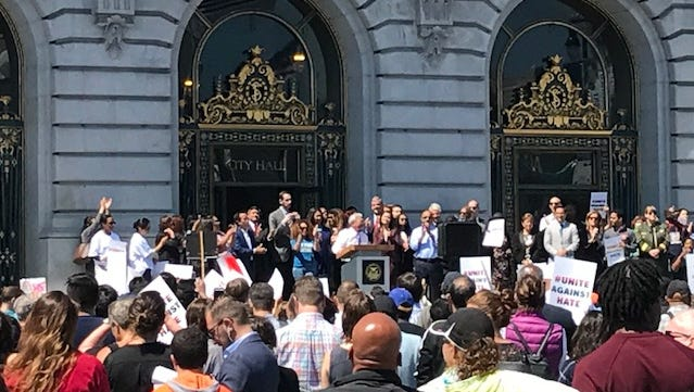 San Francisco Mayor Ed Lee and city leaders speak at a rally against hate at City Hall.