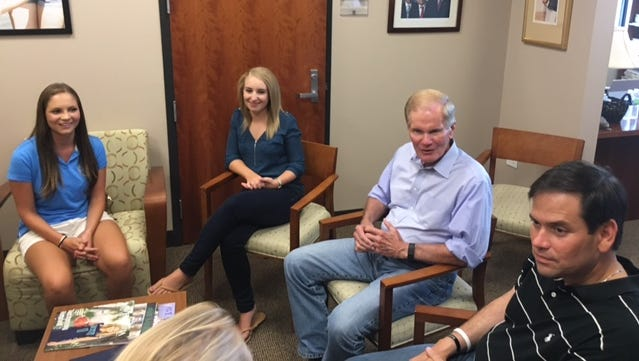 U.S. Sens. Bill Nelson and Marco Rubio talk to Ave Maria nursing students Michelle Zettel, left, and Rachel Lewandowski about their experiences caring for elderly residents from Immokalee during Hurricane Irma.