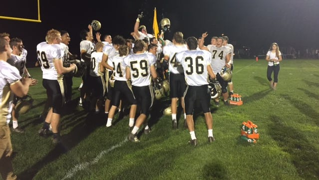 Delone Catholic celebrates following its 21-7 win over York Catholic on Friday.