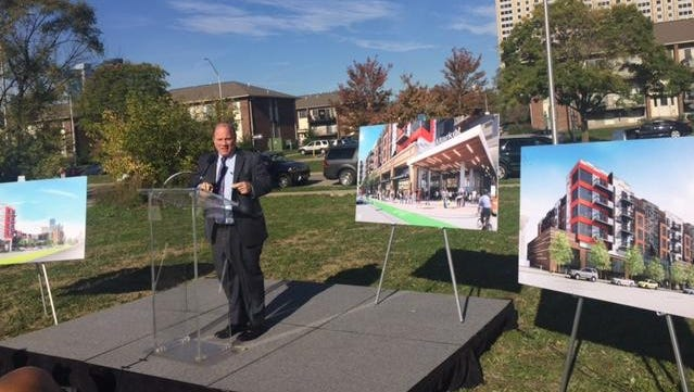 Detroit Mayor Mike Duggan speaks at the vacant site on East Jefferson where a Meijer is set to be built.