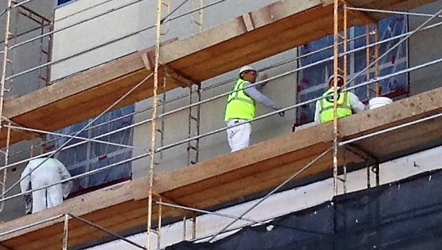 Workers do construction Friday on the Courtyard by Marriott Hotel at Santa Fe Street and Interstate-10 in Downtown El Paso. El Paso added an estimated 700 construction jobs in the past 12 months, which helped decrease unemployment, which was at 3.7 percent in December.