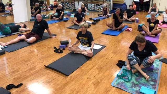 A bulletin enclosed in a Town of Jupiter water bill listed classes offered at Jupiter Community Center. The Connected Warriors yoga program is professional in every way, and is provided free to veterans and their family members.