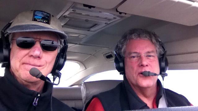 George Hager, right, and Sandy Gilmour have flown back and forth across the country in this Cessna 182.