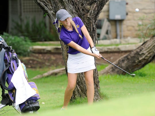 Wylie's Brylee Valentine hits her second shot on the 11th hole during the first round of the UIL Class 4A state tournament on Monday. Valentine shot a first-round 97.
