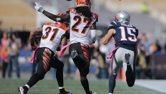 Bengals cornerback Dre Kirkpatrick is called for illegal contact penalty as he defends Patriots wide receiver Chris Hogan.