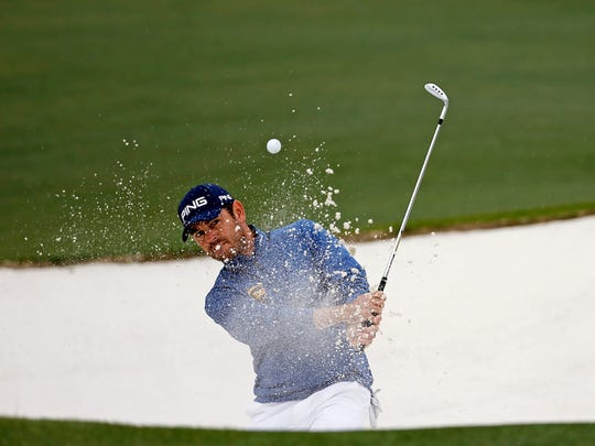 Louis Oosthuizen, of South Africa, chips out of a bunker