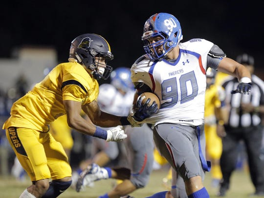 Americas junior linebacker Kolton Lindemann picks up a couple of yards after he intercepted a pass in a showdown versus Eastwood in September.