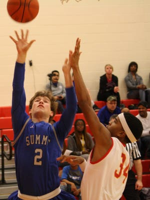 Summit Country Day junior forward Nathan Melson, No. 2, shoots over North College Hill's Tyrell Packer in a game on Jan. 23.