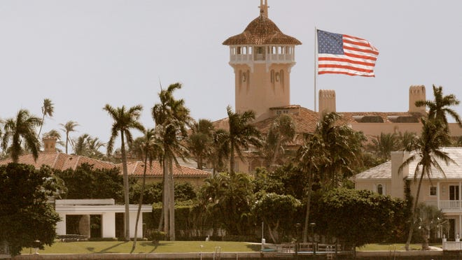 A 15 by 25 foot American flag hangs over Palm Beach and Donald Trump's Mar-a-Lago.