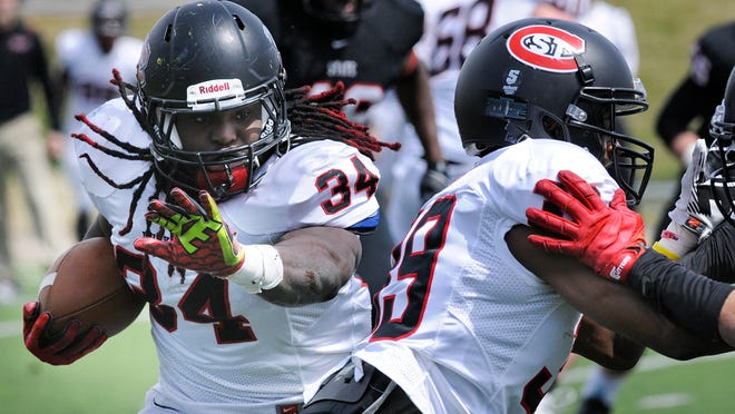 Ledell White rushes during Saturday's spring football scrimmage at St. Cloud State University.