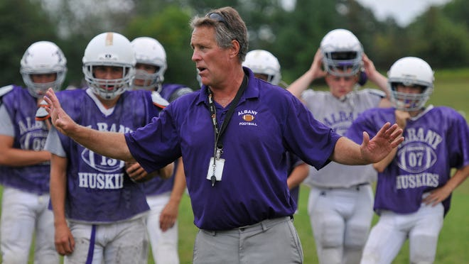 Albany High School Head Coach Mike Kleinschmidt talks about a new play he wants to introduce to players in practice Thursday, Aug. 21 at Albany High School.