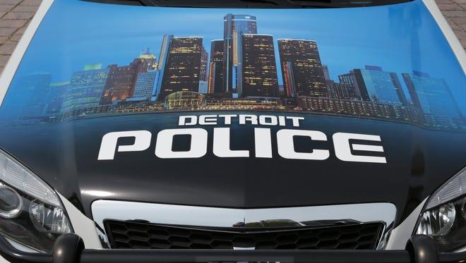Detroit skyline on the hood of a Detroit Police Department cruiser.