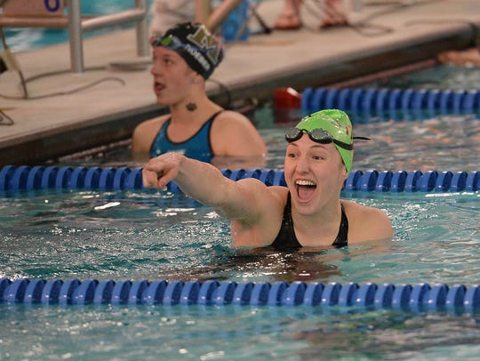 Bailey Kovac reacts after winning the 100 yard breaststroke