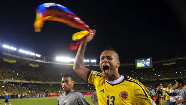 Colombia's midfielder Fredy Guarin celebrates after qualifying for the 2014 World Cup after a 3-3 tie with Chile. Colombia earned its first World Cup berth since 1998.