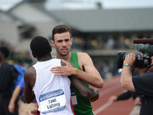 Oregon's Mac Fleet is congratulated by Arizona's Lawi Lalang after winning the 1500 meters during the final day of the NCAA Outdoor Track & Field Championships at Historic Hayward Field in Eugene on Saturday, June 14, 2014.