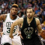 Milwaukee Bucks guard Tyler Ennis drives to the basket against Boston Celtics guard Marcus Smart (36) during the first half Friday night at TD Garden in Boston.