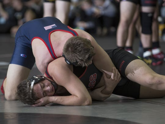 Brent Bartzak works to control Jackson's Shimonovich during their 182 lbs. bout. Menham's Jackson Memorial vs Mendham in  Semifinal of NJSIAA Public  Group Team Wrestling Championships  in Toms River, NJ on February 12, 2017