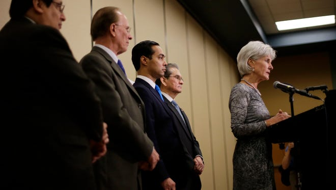 Health and Human Services Secretary Kathleen Sebelius, right, is backed by city leaders as she answer questions about the Affordable Care Act enrollment during a news conference on Oct. 25, 2013, in San Antonio.