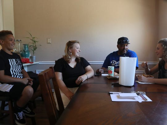 Derick Anderson, his wife, Megan, and their kids Grant and Kandyce spend the morning together at their home in Redding. Anderson and his wife married in December.