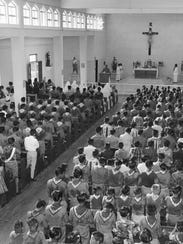 This undated Pacific Daily News file photo shows Boy Scouts at Mass on Guam. In earlier years, altar boys were required to join the Boy Scouts, and Scouts were encouraged to participate in church life.