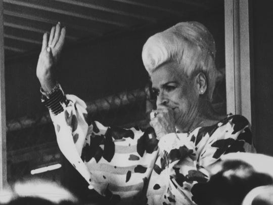 Governor Rose Mofford waves to baseball fans at Hohokam park as she and more than 8,000 others enjoy the game between the Chicago Cubs and the Seattle Mariners in 1988.