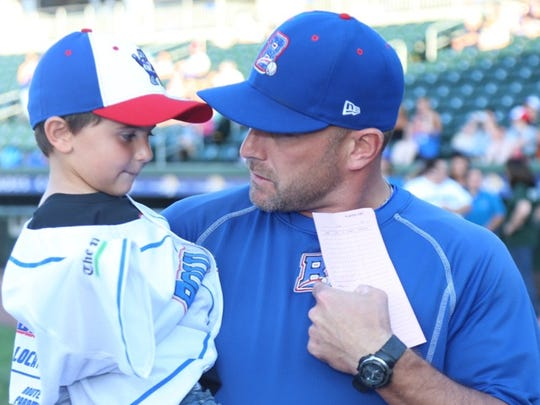Lucciano 'Lucca' DiMarco, 4, of Harrison, with Rockland Boulders Manager Jamie Keefe at the Aug. 4 Boulders game.