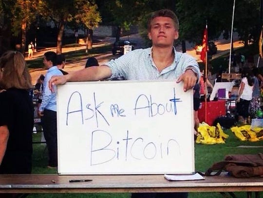 """Ask me about Bitcoin"": Cameron Schorg is shown at"