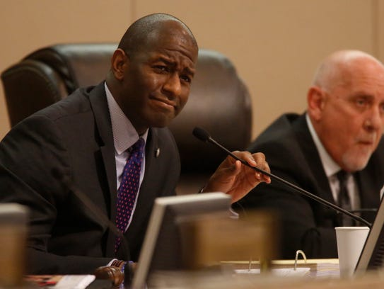 Mayor Andrew Gillum listens to Erwin Jackson's comments
