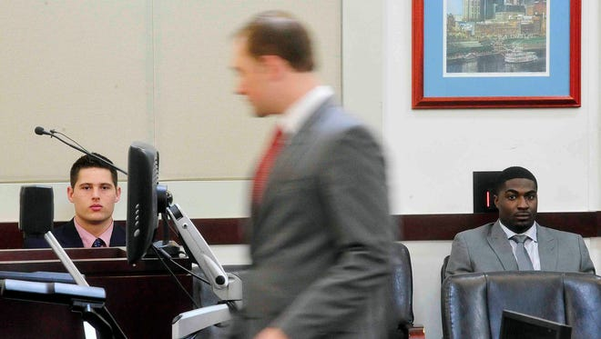 Former Vanderbilt football players Brandon Vandenburg, left, and Cory Batey, right, attend the first day of jury selection in their trial Monday, Jan. 12, 2015, in Nashville, Tenn. Vandenburg and Batey are each charged with five counts of aggravated rape and two counts of aggravated sexual battery. Vandenburg also faces additional charges of tampering with evidence and unlawful photography. (AP Photo/The Tennessean, Samuel M. Simpkins) NO SALES