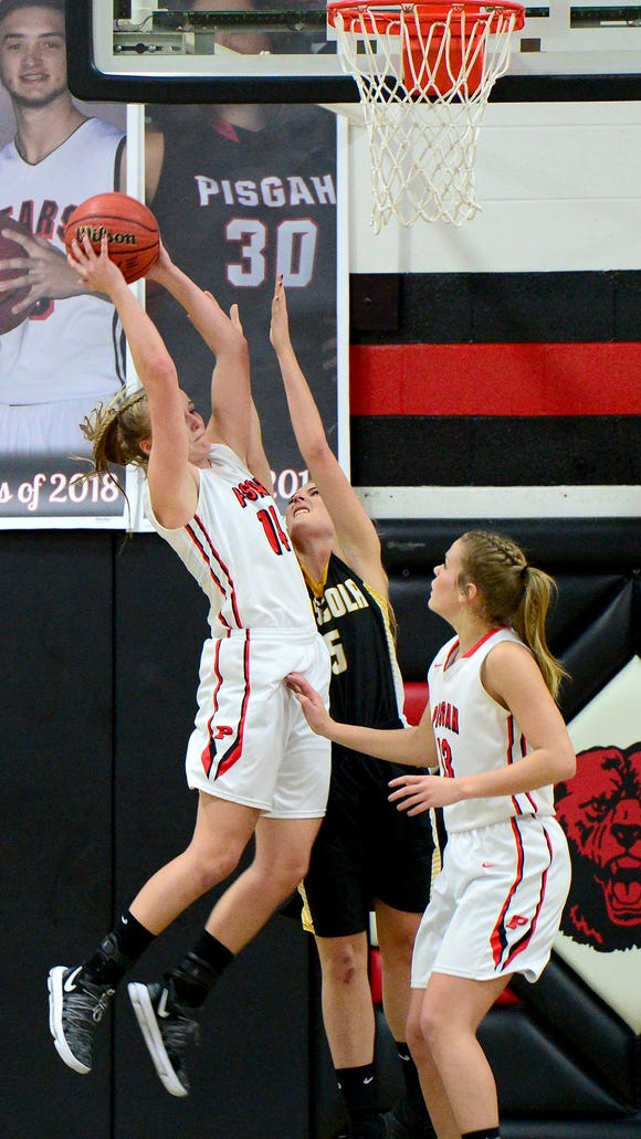 Pisgah's Emma Sorrells grabs a defensive rebound above