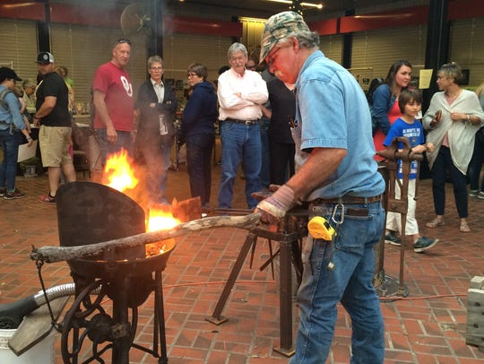 Larry Roderick fires up scrap metal that he turned
