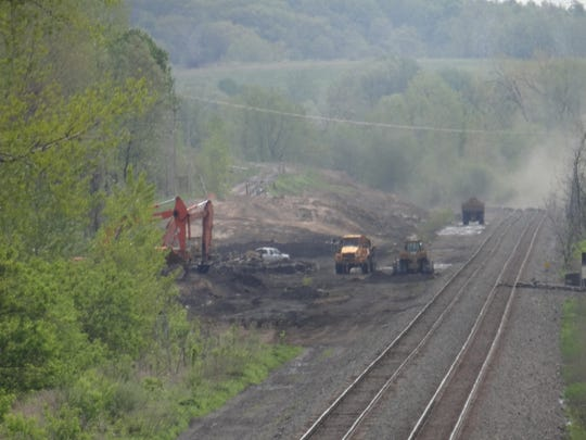 A file photo showing work  on a roadbed for a new rail spur that trains nowl use to deliver solid waste to High Acres Landfill in Perinton and Macedon, Wayne County.