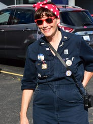 Peggy Schneider leads the Rosie the Riveters, a drill