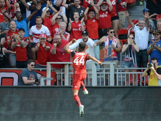 Toronto FC's Raheem Edwards celebrates with the crowd after scoring a goal against New York City FC during the second half of their MLS soccer game, Sunday, July 30, 2017 in Toronto. (Jon Blacker/The Canadian Press via AP)