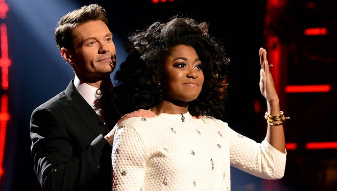 """Host Ryan Seacrest, left, and eliminated contestant Majesty Rose on """"American Idol XIII"""" airing Thursday, March 27, on Fox."""