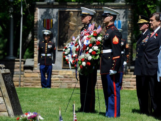 A wreath is laid at the annual Memorial Day observance at Dulaney Valley Memorial Gardens in Timonium, Md.
