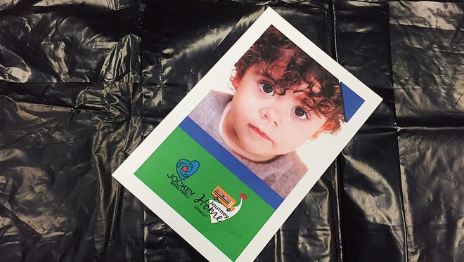 Reporter Jackie Rehwald participated in the Journey Home foster care simulation. She was given a trash bag and assigned to be this 2-year-old girl.