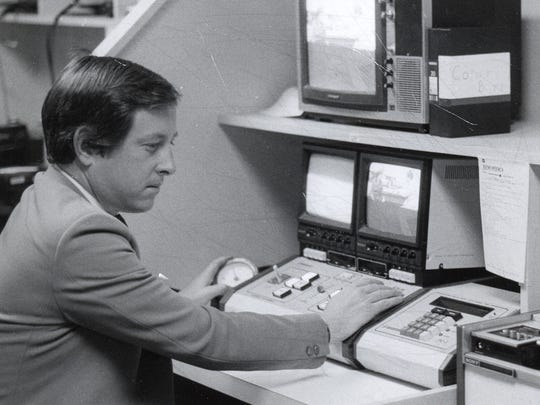 An early photo showing Marselis Parsons at work at the South Burlington station.