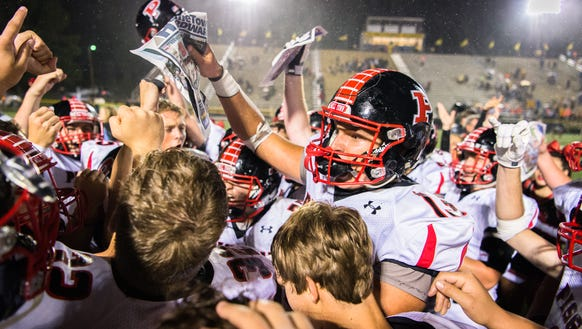 The Pisgah Bears celebrate after defeating their rival