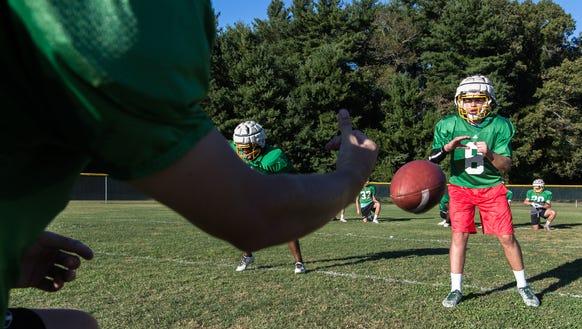 Christ School's Navy Shuler runs through plays during