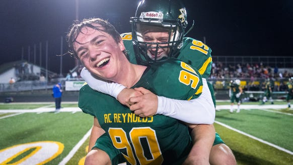 Reynolds' Tyler Wilson and Sidney Shoop celebrate following