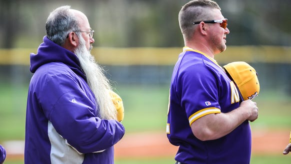 North Henderson baseball coach, John Street, on left,