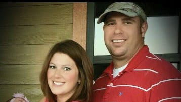 Funeral services have been set for firefighter Jordan Howard, pictured with his wife and daughter.