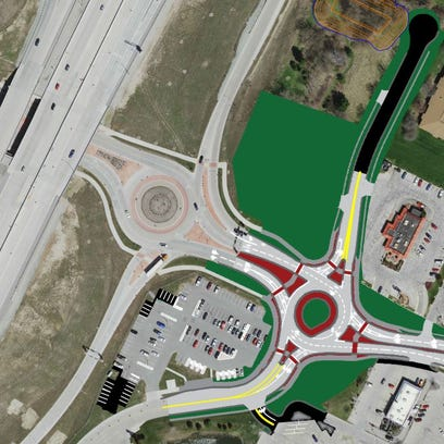 A roundabout at Main Street and Lawrence Drive in De