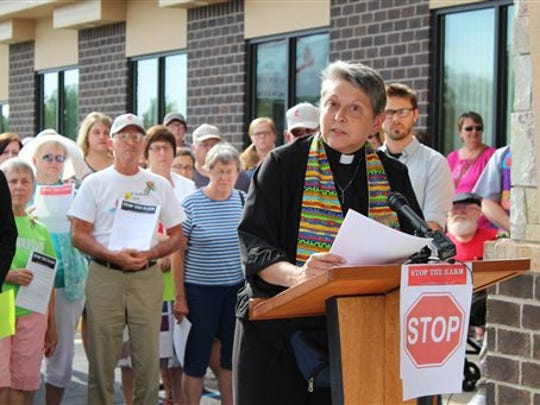The Rev. Lois McCullen Parr speaks in favor of LGBT inclusiveness at an event supporting the Rev. Benjamin Hutchison in Lansing, Mich., on Tuesday, July 28, 2015.