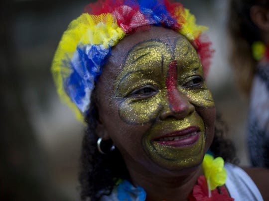 "A patient from the Nise da Silveira Mental Health Institute takes part on a carnival parade coined, in Portuguese: ""Loucura Suburbana,"" or Suburban Madness, in the streets of Rio de Janeiro, Brazil, Thursday, Feb. 23, 2017. Patients, their relatives and institute workers held their parade one day before the official start of Carnival."