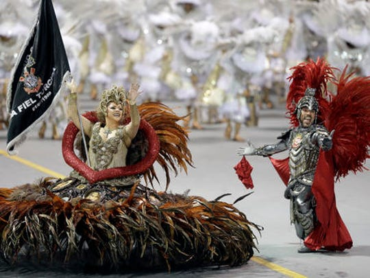 Dancers from the Gavioes da Fiel samba school perform during a carnival parade in Sao Paulo, Brazil, early Saturday, Feb. 25, 2017.